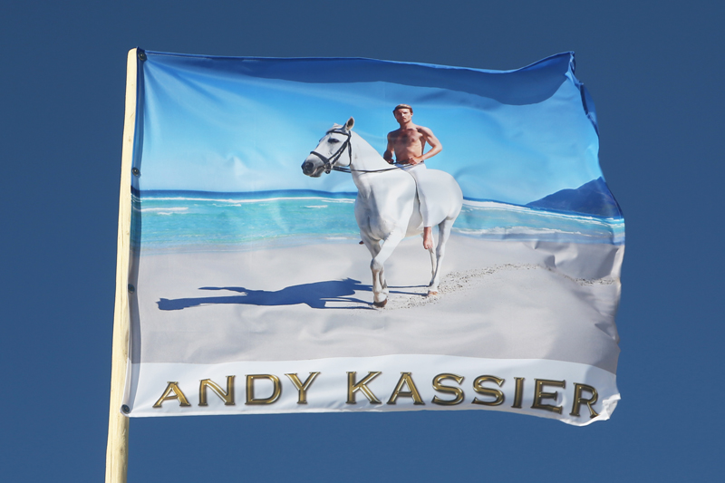 "<p style=""text-align: center;""><span style=""font-size: 8pt;"">Andy Kassier, White Horse, 2018, CMYK print on flag fabric, 107,5 x 130 cm, Edition 1/4, Kunstverein Amrum, 2018. Photo: Sandra Hermannsen"